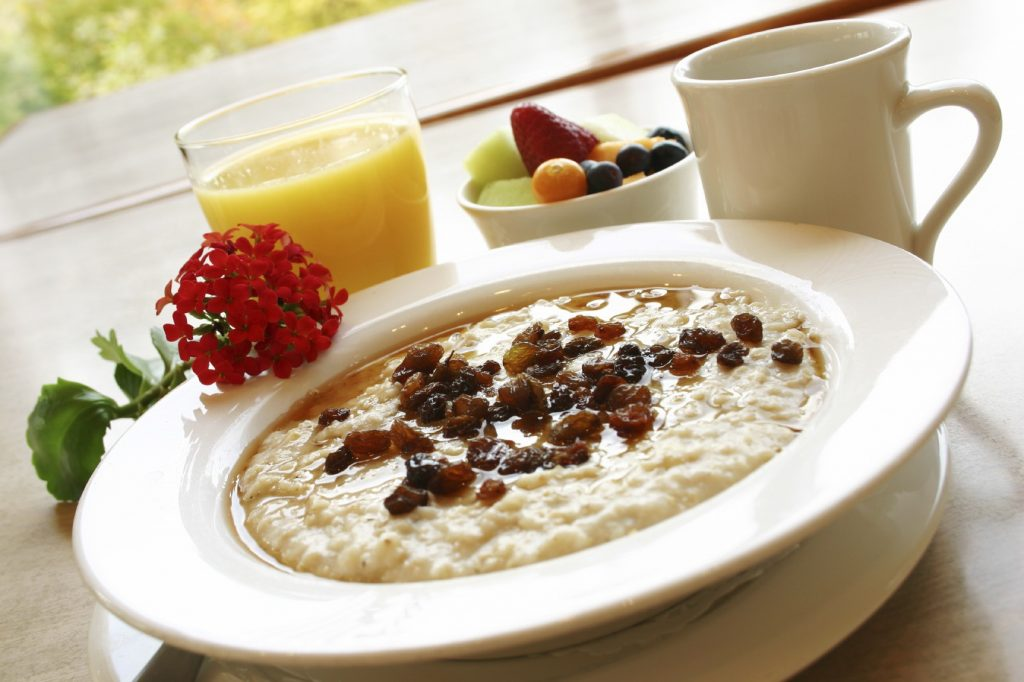 Breakfast of freshly prepared oatmeal topped with raisins. Served with your choice of coffee or orange juice and a cup of fruit.
