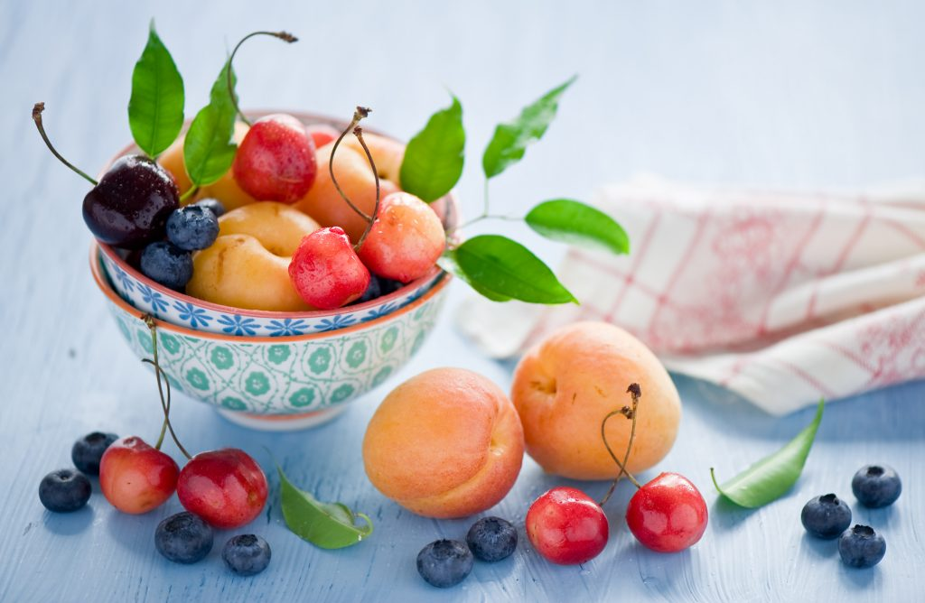 food-bowl-fruit-wallpaper-hd-fresh-peach-cherries-blueberries-leaves